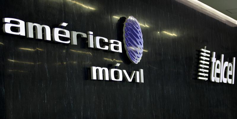 The logos of America Movil and its commercial brand Telcel are seen in the company's new corporate offices in Mexico City