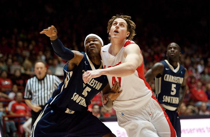 New Mexico's Cameron Bairstow, right, battles Charleston Southern's Paul Gombwer for a rebound in the first half of an NCAA basketball game, Sunday, Nov. 17, 2013 in Albuquerque, N.M