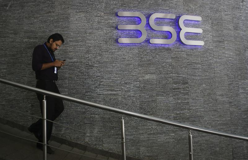 An employee walks out of the Bombay Stock Exchange (BSE) building in Mumbai