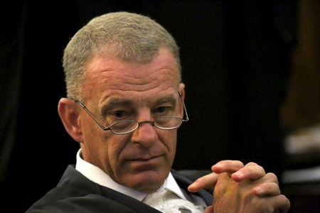 FILE PHOTO - Prosecutor Gerrie Nel is seen ahead of an appeal by state prosecutors against South African paralympian Oscar Pistorius's conviction last year at the Supreme Court of Appeal (SCA) in Bloemfontein, November 3, 2015.  REUTERS/Siphiwe Sibeko/File Photo