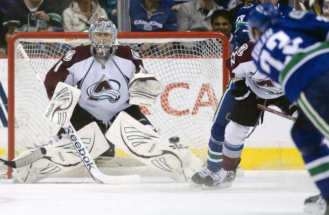 VANCOUVER, CANADA - MARCH 28: Goalie Semyon Varlamov #1 of the Colorado Avalanche stops the shot of Alexander Edler #23 of the Vancouver Canucks during the first period in NHL action on March 28, 2012 at Rogers Arena in Vancouver, British Columbia, Canada.  (Photo by Rich Lam/Getty Images)