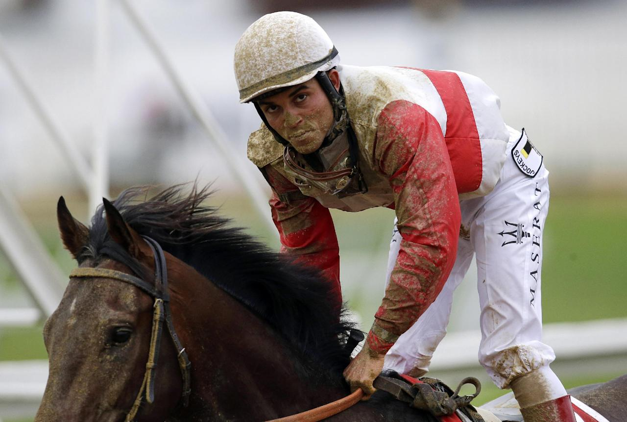 Orb, with jockey Joel Rosario aboard, gallops back to the paddock after the 138th Preakness Stakes horse race at Pimlico Race Course, Saturday, May 18, 2013, in Baltimore. Oxbow won the race, Orb, the Kentucky Derby winner, finished fourth. (AP Photo/Patrick Semansky)