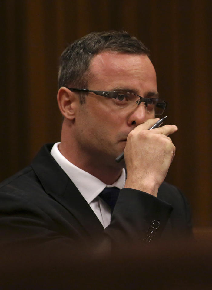 Oscar Pistorius listens to cross questioning during his trial in court in Pretoria, South Africa, Monday, March 17, 2014. Pistorius is on trial for the murder of his girlfriend, Reeva Steenkamp, on Valentine's Day, 2013. (AP Photo/Siphiwe Sibeko, Pool)