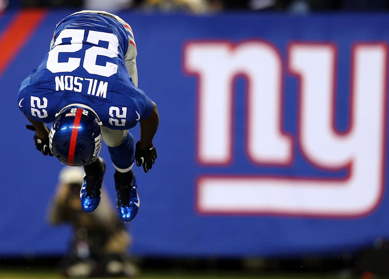EAST RUTHERFORD, NJ - DECEMBER 09:  David Wilson #22 of the New York Giants celebrates his touchdown in the first quarter against the New Orleans Saints on December 9, 2012 at MetLife Stadium in East Rutherford, New Jersey.  (Photo by Elsa/Getty Images)