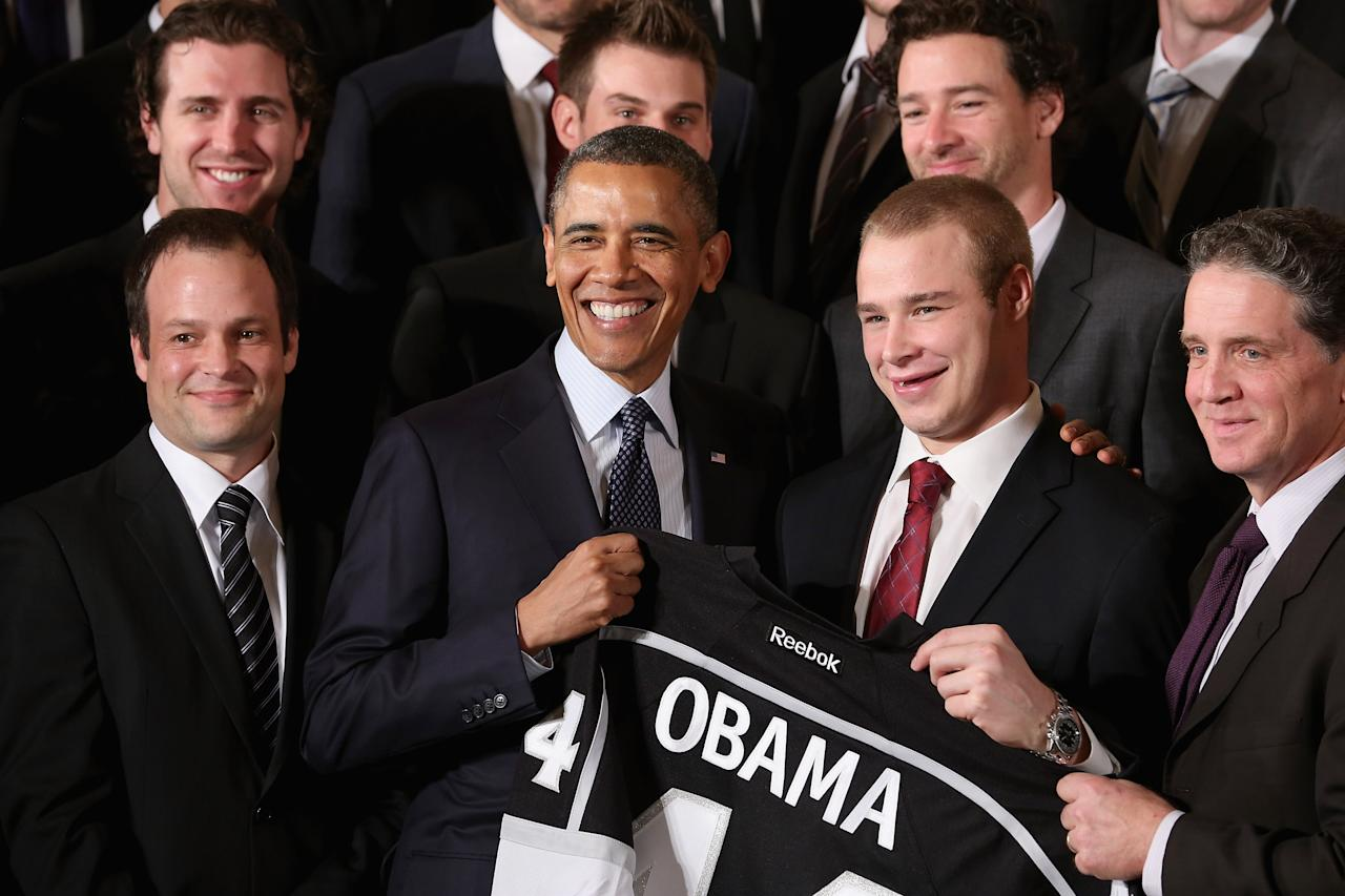 WASHINGTON, DC - MARCH 26:  U.S. President Barack Obama (C) poses with Dustin Brown (2nd R) and other members of the National Hockey League Stanley Cup winning Los Angeles Kings in the East Room of the White House March 26, 2013 in Washington, DC. After the White House honors both the Kings and the Major League Soccer champion Los Angeles Galaxy, players participated in a question-and-answer panel with Sam Kass, Assistant White House Chef and Executive Director of first lady Michelle Obama's health program 'Let's Move!'  (Photo by Chip Somodevilla/Getty Images)