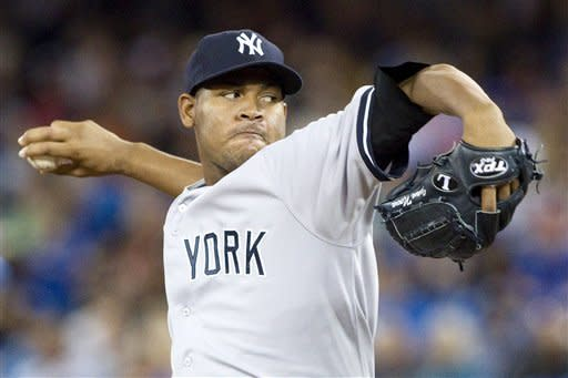 New York Yankees starting pitcher Ivan Nova works against the Toronto Blue Jays  during the first inning of a baseball game in Toronto on Saturday, Aug. 11 , 2012. (AP Photo/The Canadian Press, Chris Young)