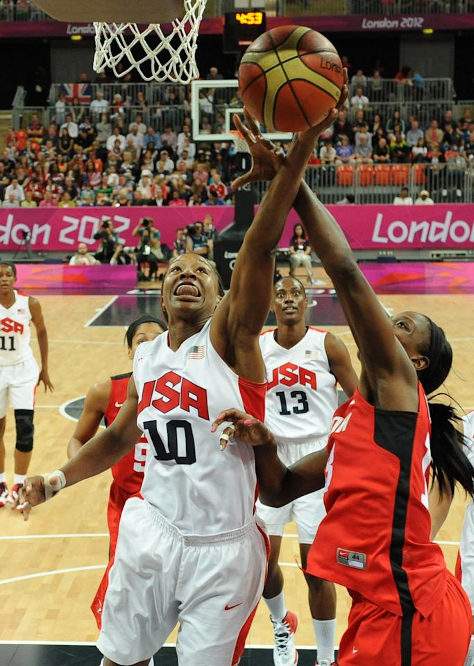 LONDON, ENGLAND - AUGUST 07:  US forward Tamika Catchings (L) vies with Canadian forward Tamara Tatham during the Women's Basketball quaterfinal on Day 11 of the London 2012 Olympic Games at the Basketball Arena on August 7, 2012  in London, England.  (Photo by Mark Ralston - IOPP Pool Getty Images)