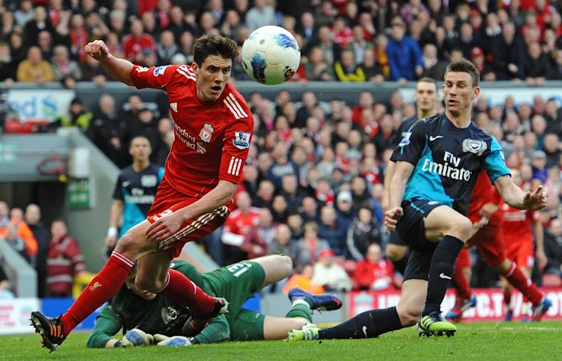 Liverpool's English defender Martin Kelly (L) during the English Premier League football match between Liverpool and Arsenal at Anfield on March 3, 2012