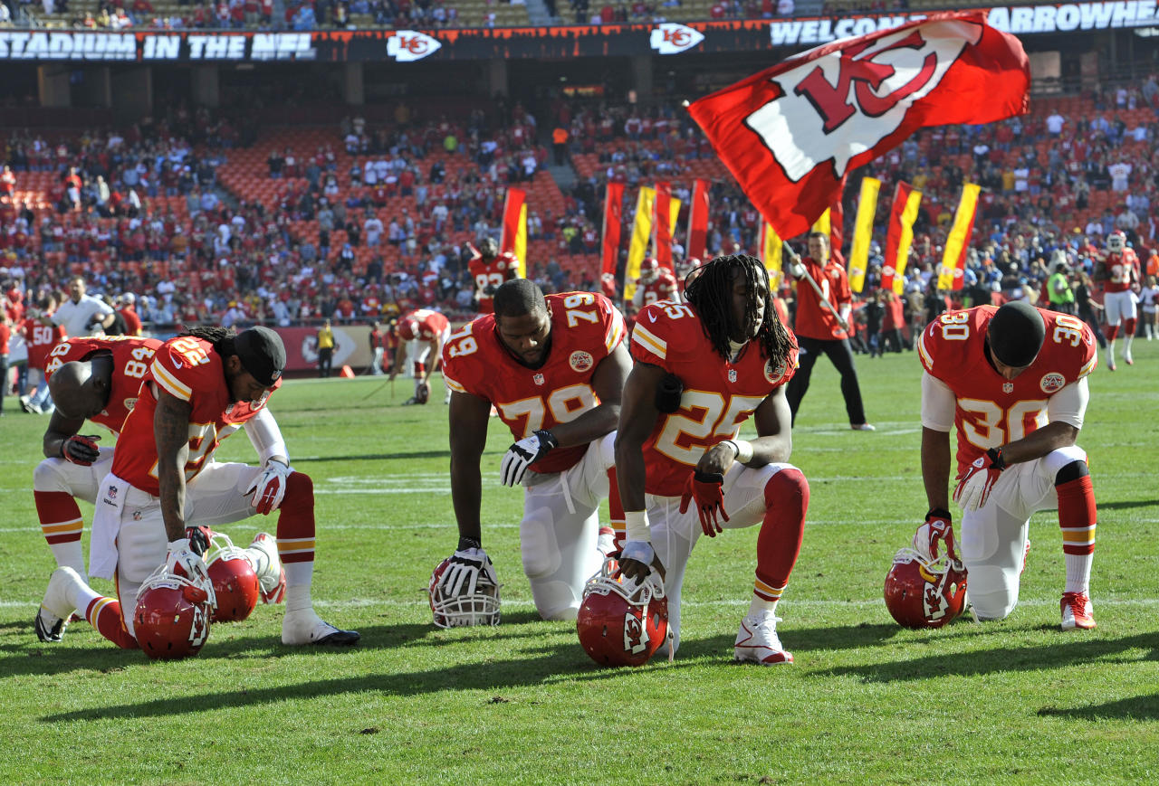 KANSAS CITY, MO - DECEMBER 02: The Kansas City Chiefs neel and pray before a game against the Carolina Panthers on December 2, 2012 at Arrowhead Stadium in Kansas City, Missouri. (Photo by Peter Aiken/Getty Images)
