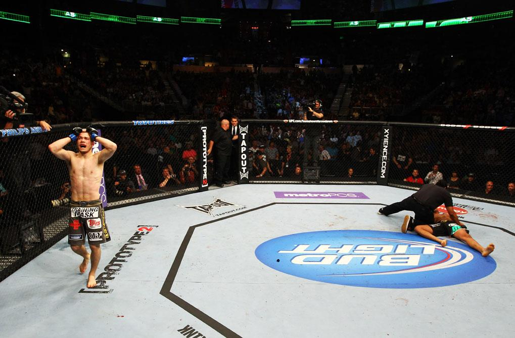 ATLANTA, GA - APRIL 21:  Michael McDonald (L) celebrates defeating Miguel Angel Torres (R) by knockout in the first round during their Bantamweight bout for UFC 145 at Philips Arena on April 21, 2012 in Atlanta, Georgia.