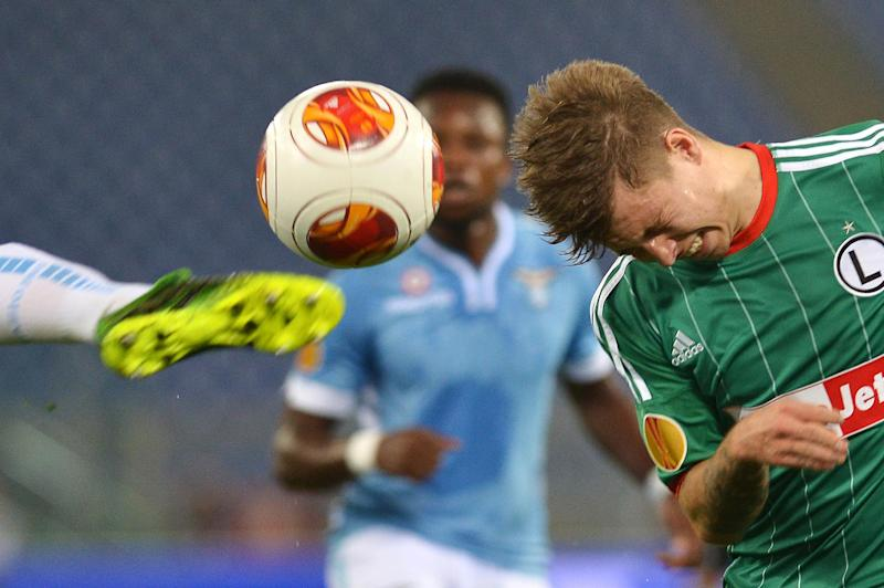 Legia Warsaw midfielder Jakub Kosecki heads the ball during a Europa League match on September 19, 2013, at the Olympic stadium in Rome