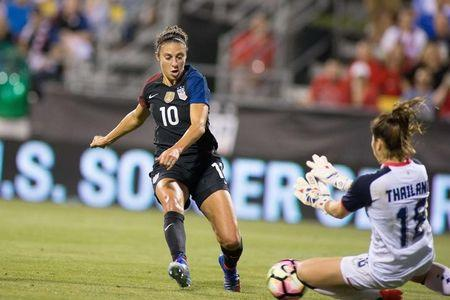 Sep 15, 2016; Columbus, OH, USA; USA midfielder Carli Lloyd (10) shoots the ball past Thailand goalkeeper Yada Sengyong (18) in the first half at MAPFRE Stadium. The USA defeated Thailand 9-0. Mandatory Credit: Trevor Ruszkowski-USA TODAY Sports