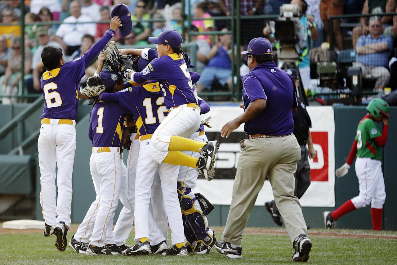 Aguadulce, Panama players celebrate after their 2-1 win in a baseball game against Nuevo Laredo, Mexico at the Little League World Series, Thursday, Aug. 23, 2012, in South Williamsport, Pa. (AP Photo/Matt Slocum)