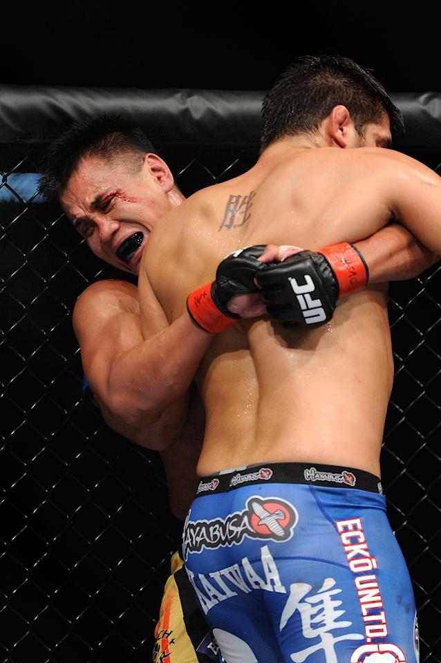 Cung Le, left, and Patrick Cote battle it out during their UFC 148 middleweight fight at the MGM Grand Garden Arena, Saturday, July 7, 2012, in Las Vegas. Le won by unanimous decision. (AP Photo/David Becker)