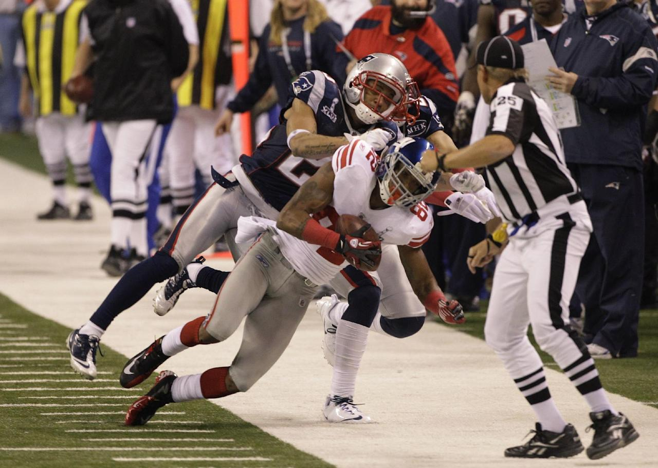 New York Giants wide receiver Mario Manningham (82) makes a catch at the sideline as New England Patriots free safety Patrick Chung defends during the second half of the NFL Super Bowl XLVI football game, Sunday, Feb. 5, 2012, in Indianapolis. (AP Photo/David Duprey)
