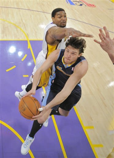 Denver Nuggets forward Danilo Gallinari, right, of Italy goes up for a shot as Los Angeles Lakers center Andrew Bynum during the first half of an NBA first-round playoff basketball game, Sunday, April 29, 2012, in Los Angeles. (AP Photo/Mark J. Terrill)