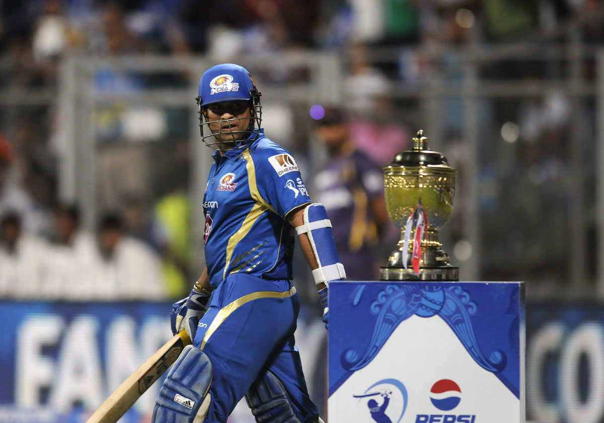 Sachin Tendulkar of Mumbai Indians has a closer look at the IPL trophy as he walks to bat during match 53 of the Pepsi Indian Premier League ( IPL) 2013  between The Mumbai Indians and the Kolkata Knight Riders held at the Wankhede Stadium in Mumbai on the 7th May 2013 ..Photo by Pal Pillai-IPL-SPORTZPICS  ..Use of this image is subject to the terms and conditions as outlined by the BCCI. These terms can be found by following this link:..http://www.sportzpics.co.za/image/I0000SoRagM2cIEc