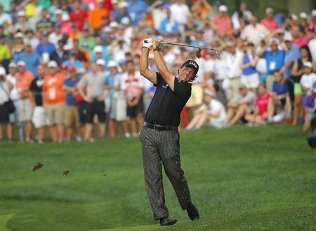 Phil Mickelson of the U.S. hits his second shot on the 12th hole during the final round of the 2014 PGA Championship at Valhalla Golf Club in Louisville