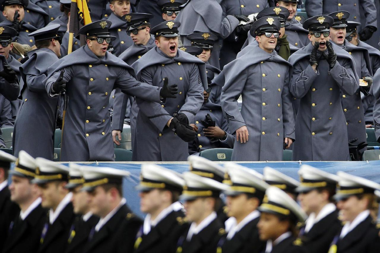 Army cadets, top, call out to Navy midshipmen as they march on the field beforean NCAA college football game, Saturday, Dec. 14, 2013, in Philadelphia. (AP Photo/Matt Slocum)