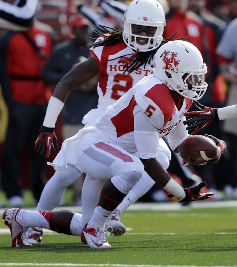 O'Korn throws 5 TDs, Houston routs Rutgers 49-14
