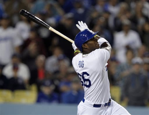 Los Angeles Dodgers' Yasiel Puig hits a grand slam home run in the eighth inning against the Atlanta Braves during a baseball game Thursday, June 6, 2013, in Los Angeles. The Dodgers won the game 5-0. (AP Photo/Alex Gallardo)