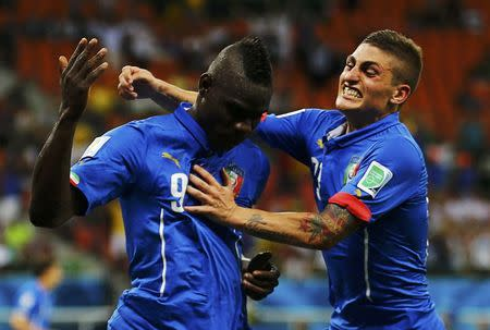 Italy's Balotelli celebrates his goal against England with Verratti during their 2014 World Cup Group D soccer match at the Amazonia arena in Manaus