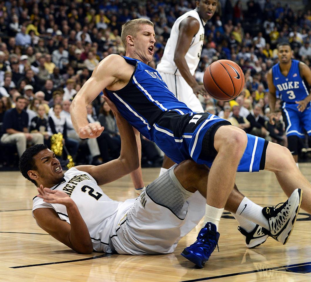 Duke forward Mason Plumlee (5) falls onto Wake Forest forward Devin Thomas (2) during first-half action at Lawrence Joel Memorial Coliseum in Winston-Salem, North Carolina, Wednesday January 30, 2013. (Chuck Liddy/Raleigh News & Observer/MCT)