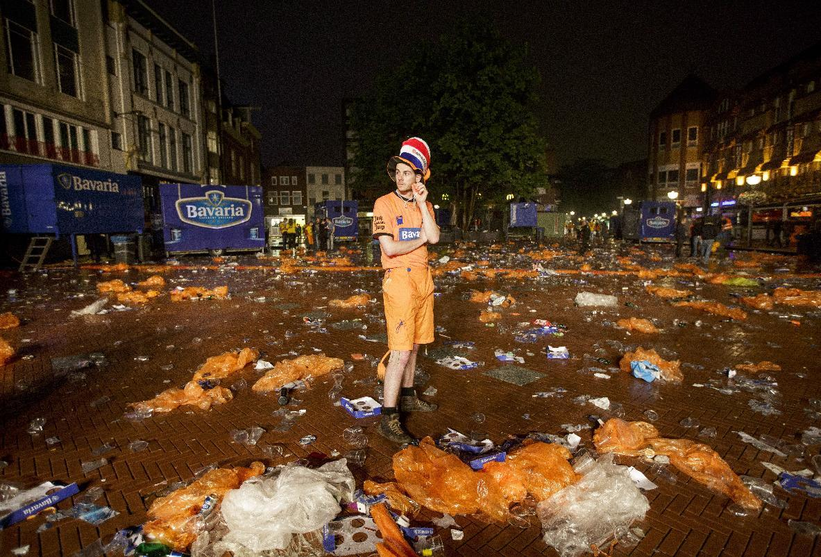 A soccer fan stands in disappointment after Netherlands lost the World Cup soccer semifinal match against Argentina, in the center of Eindhoven, Netherlands, Wednesday, July 9, 2014. (AP Photo/Phil Nijhuis)