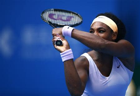 Serena Williams of the U.S. returns the ball during her match against Maria Kirilenko of Russia at the China Open tennis tournament in Beijing