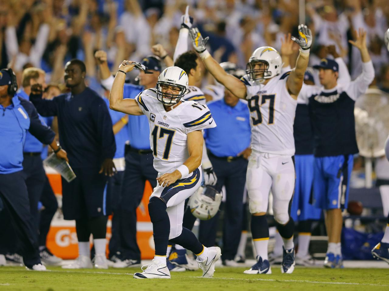 San Diego Chargers quarterback Philip Rivers (17) celebrates a first half touchdown against the Houston Texans during their Monday Night NFL football game in San Diego, California September 9, 2013. REUTERS/Mike Blake (UNITED STATES - Tags: SPORT FOOTBALL)