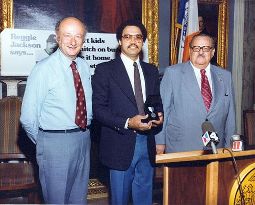 (L-R) New York City Mayor Ed Koch, Yankees outfielder Reggie Jackson, and MTA chairman Harold Fisher, September 14, 1979. Jackson served as a spokesman for an MTA anti-fare-evasion campaign.