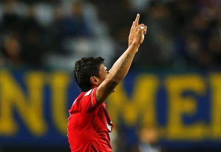 Paulinho of China's Guangzhou Evergrande celebrates after scoring against Mexico's Club America during their Club World Cup quarter-final soccer match in Osaka, western Japan, December 13, 2015.  REUTERS/Thomas Peter
