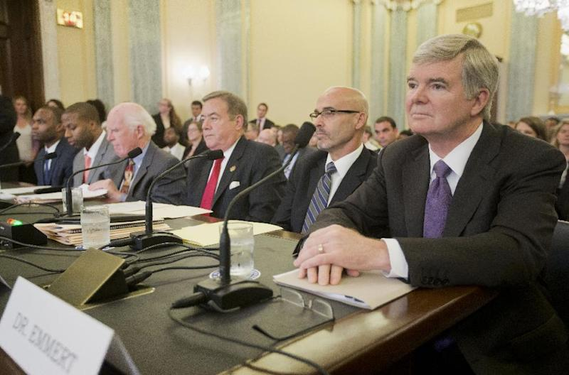 National Collegiate Athletic Association (NCAA) President Mark Emmert, right, waits to testify on Capitol Hill in Washington, Wednesday, July 9, 2014, before the Senate Commerce hearing on the NCAA's treatment of athletes. From left are, Myron Laurent Rolle, student Florida State College of Medicine, former college football player, Florida State, Devon Jahmai Ramsay, former college football player, University of North Carolina, Taylor Branch, author and historian, William Bradshaw, former Athletic Director, Temple University, Dr. Richard M. Southall, Associate Professor, Department of Sport and Entertainment Management, and Emmert