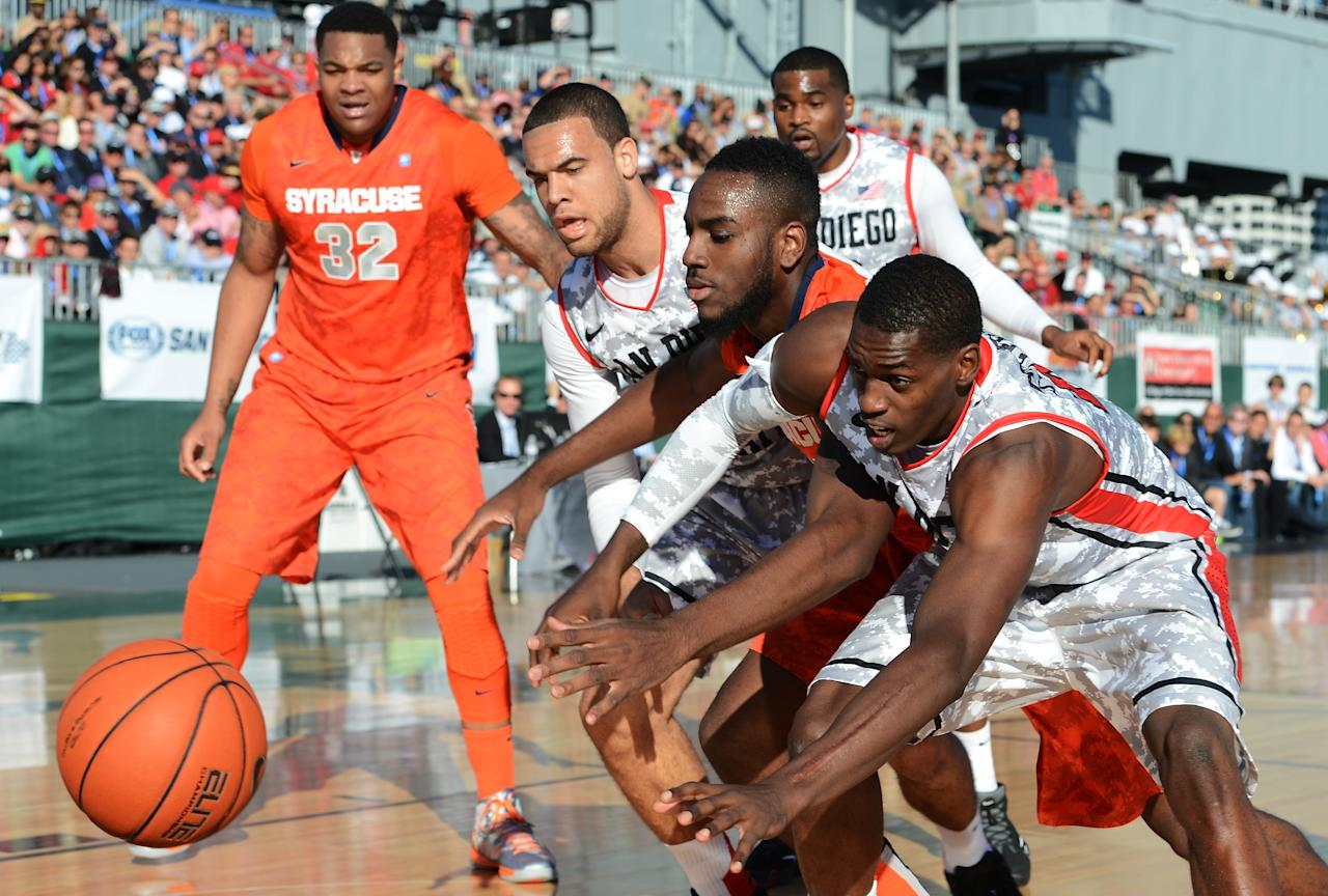 SAN DIEGO, CA - NOVEMBER 11:  Rakeem Christmas #25 of the Syracuse Orange vies for the ball between JJ O'Brien #20 and Deshawn Stephens #23 of the San Diego State Aztecs during the second half of the Battle On The Midway on board the USS Midway Aircraft Carrier on November 11, 2012 in San Diego, California.  (Photo by Harry How/Getty Images)