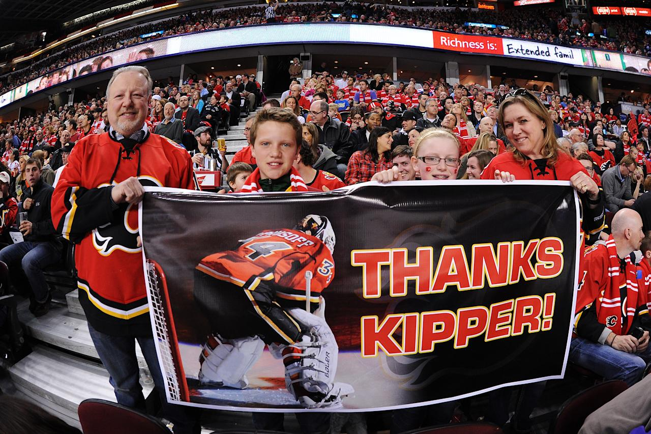 CALGARY, CANADA - APRIL 19: A family of Calgary Flames fans holds a banner that says 'Thanks Kipper!' to honor what could be Miikka Kiprusoff's last game during the game against the Anaheim Ducks at Scotiabank Saddledome on April 19, 2013 in Calgary, Alberta, Canada. (Photo by Derek Leung/Getty Images)