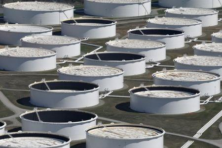 Oil prices fall on US crude stocks build; fears over China demand