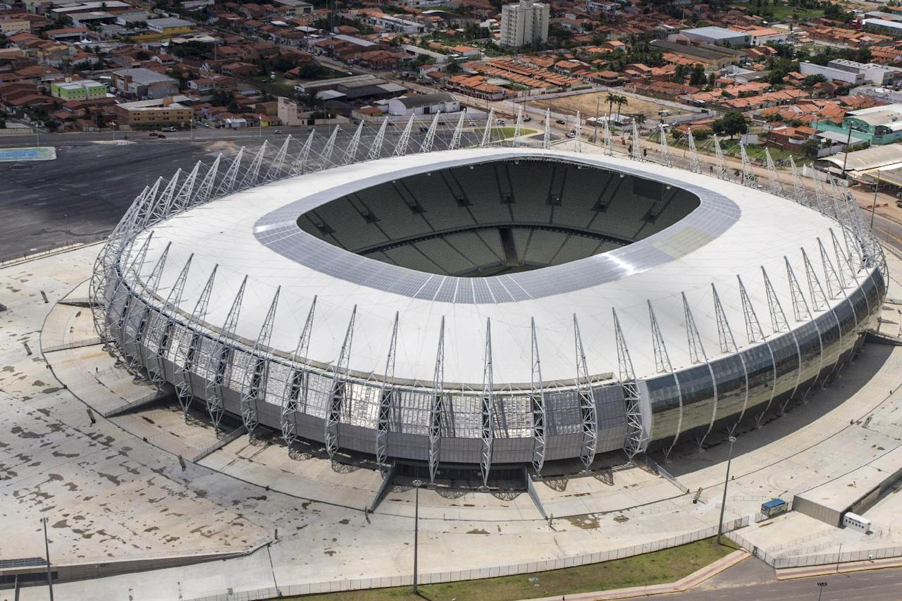 FILE- This March 13, 2014, file photo released by Portal da Copa shows an aerial view of the Castelao stadium in Fortaleza, Brazil. Castelao will host matches during the 2014 World Cup soccer tournament. (AP Photo/Fabio Lima, Portal da Copa, File)