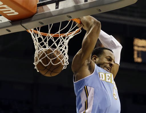 Denver Nuggets' Andre Iguodala does a reverse dunk against the Milwaukee Bucks during the first half of an NBA basketball game, Monday, April 15, 2013, in Milwaukee. (AP Photo/Jeffrey Phelps)