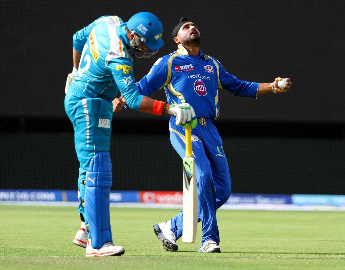 Mumbai Indian player Harbhajan Singh and Pune Warriors player Yuvraj Singh share a lighter moment during match 58 of the Pepsi Indian Premier League ( IPL) 2013  between The Pune Warriors India and the Mumbai Indians held at the Subrata Roy Sahara Stadium, Pune on the 11th May 2013. (BCCI)