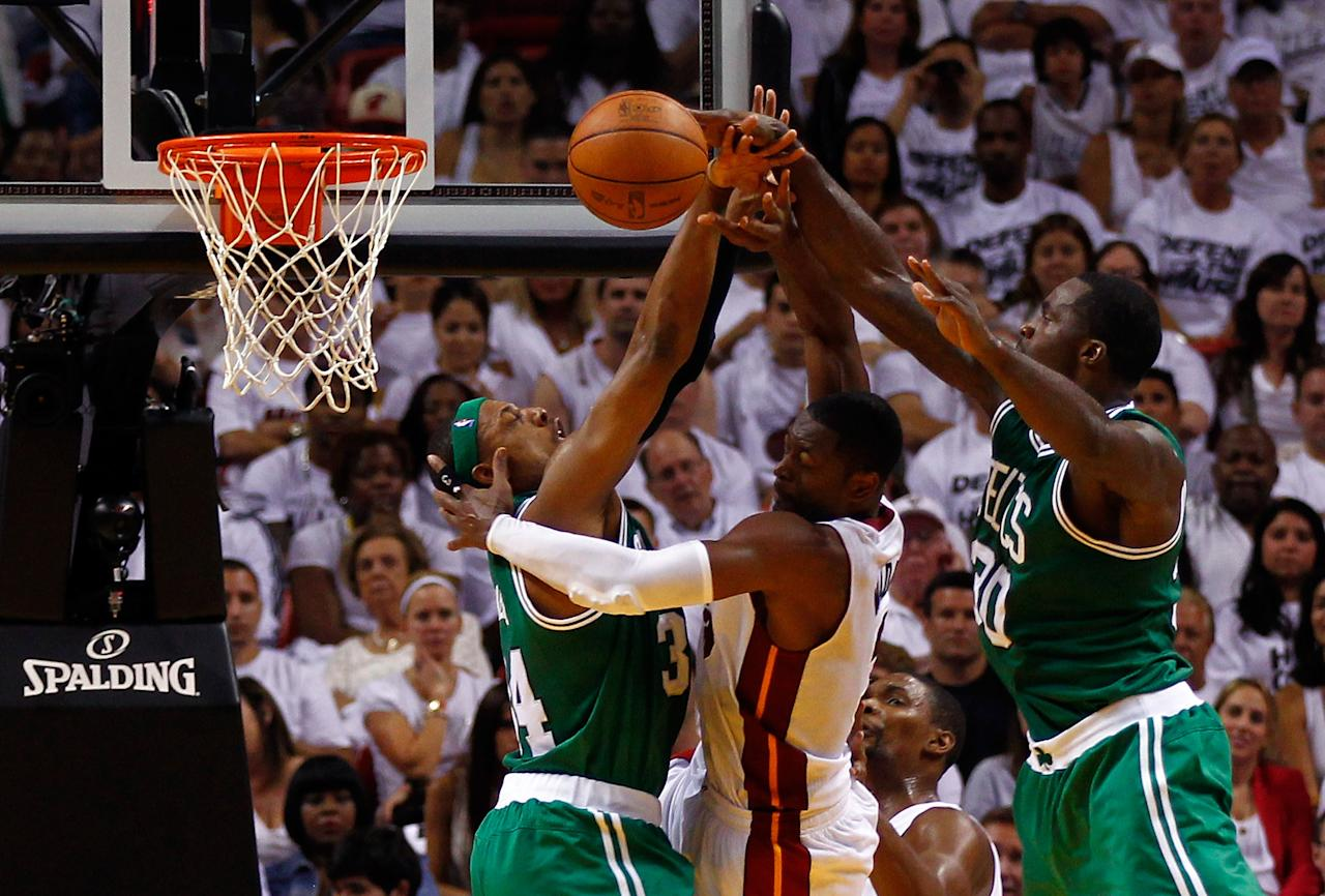 MIAMI, FL - JUNE 09:  Dwyane Wade #3 of the Miami Heat goes up between Paul Pierce #34 and Brandon Bass #30 of the Boston Celtics in the second quarter in Game Seven of the Eastern Conference Finals in the 2012 NBA Playoffs on June 9, 2012 at American Airlines Arena in Miami, Florida. NOTE TO USER: User expressly acknowledges and agrees that, by downloading and or using this photograph, User is consenting to the terms and conditions of the Getty Images License Agreement.  (Photo by Mike Ehrmann/Getty Images)