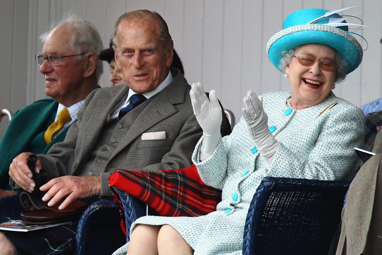 BRAEMAR, SCOTLAND - SEPTEMBER 03:  Queen Elizabeth II and Prince Philip, Duke of Edinburgh (C) attend the Braemar Highland Games at The Princess Royal and Duke of Fife Memorial Park on September 3, 2011 in Braemar, Scotland. The Braemar Gathering is the most famous of the Highland Games and is known worldwide. Each year thousands of visitors descend on this small Scottish village on the first Saturday in September to watch one of the more colorful Scottish traditions. The Gathering has a long history and in its modern form it stretches back nearly 200 years.  (Photo by Jeff J Mitchell/Getty Images)