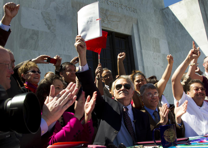 May Day activists cheer state immigration laws