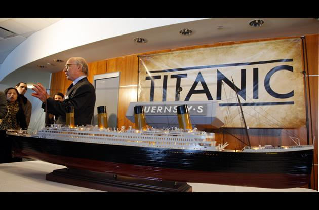 Arlan Ettinger, president of Guernsey's Auction House, standing next to a model of the Titanic, during a press conference and preview of Titanic artifacts in New York.