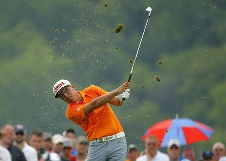 Rickie Fowler of the U.S. hits off the 8th tee during the final round of the 2014 PGA Championship at Valhalla Golf Club in Louisville