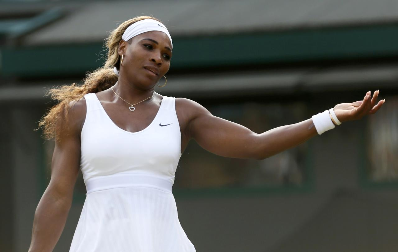 Serena Williams of the U.S. reacts during her women's singles tennis match against Alize Cornet of France at the Wimbledon Tennis Championships, in London June 28, 2014. REUTERS/Stefan Wermuth (BRITAIN - Tags: SPORT TENNIS)