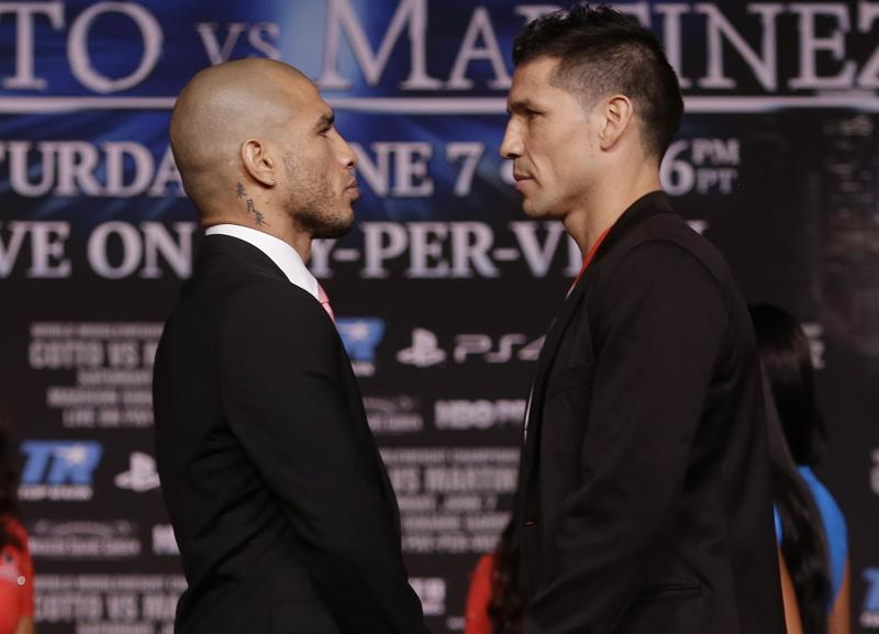 Boxers Sergio Martinez, of Argentina, right, and Miguel Cotto, of Puerto Rico, pose during a news conference for their upcoming fight Wednesday, June 4, 2014, in New York. Martinez and Cotto will fight on June 7 at Madison Square Garden in New York