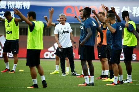 Football Soccer - Manchester United training - International Champions Cup China - Shanghai Stadium, Shanghai, China - 21/7/16 - Manchester United coach Jose Mourinho instructs players. REUTERS/Thomas Peter