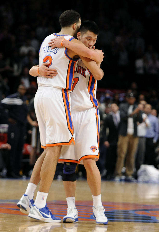 New York Knicks' Landry Fields (2) hugs Jeremy Lin after the Knicks beat the Utah Jazz 99-88 in an NBA basketball game Monday, Feb. 6, 2012, in New York. (AP Photo/Kathy Kmonicek)