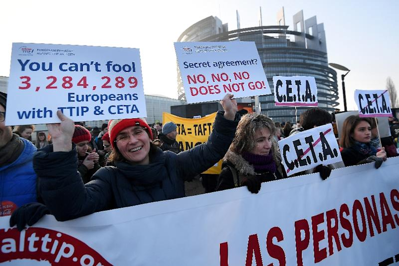 Protestors demonstrate against the EU-Canada trade deal outside the European Parliament in Strasbourg, France