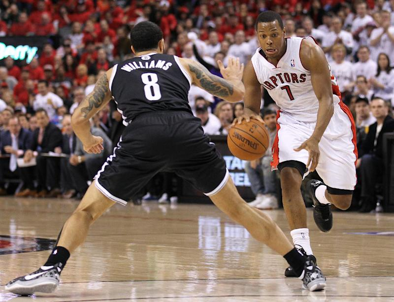 Kyle Lowry (R) of the Toronto Raptors goes up against Deron Williams of the Brooklyn Nets in Game Seven of the NBA Eastern Conference Quarterfinals on May 4, 2014 in Toronto, Ontario, Canada